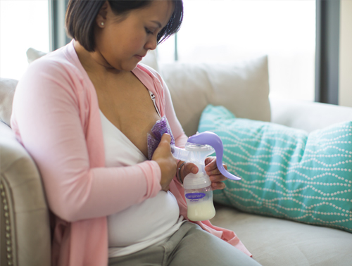 Manual Breast Pump Being Used By Lady